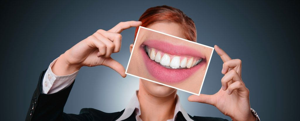 woman holding smile image